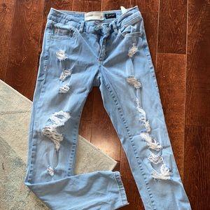 Garage Distressed light wash skinny jeans